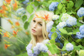 Sensible woman among fowers — Stockfoto