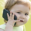 Small baby boy speaking on phone — Stock Photo #78032568