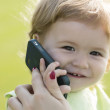 Little boy speaking on phone — Stock Photo #78493352