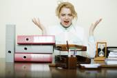 Crazy woman at office table — Stock Photo
