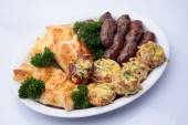 Snack plate with sausages and khachapuri — Stock Photo