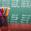 Colorful pencils of red yellow orange violet purple pink green and blue in stationary cup — Stock Photo #79521532