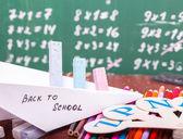 Paper plane at school lesson — Stock Photo