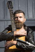 One serious man with guitar — Stock Photo