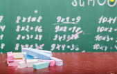 School blackboard and chalk — Stock Photo