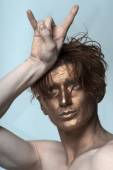 Bronzed man with cool gesture — Stock Photo