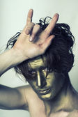 Golden man with cool gesture — Stock Photo