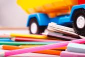 Colorful school stationary and car — Stock Photo