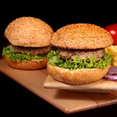 Burgers with cutlet and chips — Stock Photo