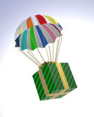 Gift Box flying on parachute — Stock Photo