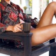 Woman with coffee at hotel terrace — Stock Photo #62163991