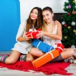Girls opening Christmas presents — Stock Photo #62168659