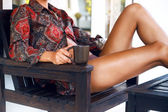 Pretty tamed fit woman drinking her  coffee — Stock Photo