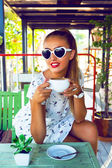 Portrait of beautiful young girl drinking tea — Stock Photo