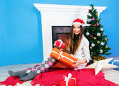 Brunette woman opening her presents — Stock Photo