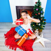 Blonde woman opening her presents — Stock Photo