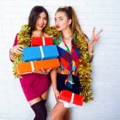 Sisters holding party gifts and presents — Stock Photo