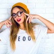 Portrait of young hipster blonde woman — Stock Photo #62171597