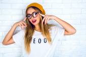 Studio portrait of young hipster blonde woman with bright sexy make up — Stock Photo