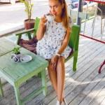 Girl drinking tea on retro terrace — Stock Photo #75374143