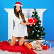 Surprised brunette girl owith her presents — Stock Photo #75375121