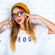Young hipster blonde woman — Stock Photo #75375485