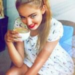 Girl drinking tea on retro terrace — Stock Photo #75375755