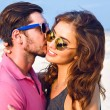 Young hipster couple wearing sunglasses — Stock Photo #75376197