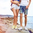 Couple in love posing at stone beach — Stock Photo #75376569