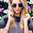 Stunning blonde young woman in sunglasses — Stockfoto #75376585