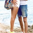 Young couple hugging at seaside — Stock Photo #75376587