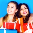 Young girls holding holiday presents — Stock Photo #75376933
