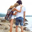 Young stylish couple posing at the beach — Stock Photo #75377111