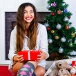 Young girl with New Year present — Stock Photo #75377839