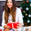 Smiling girl near Christmas tree — Stock Photo #75377845