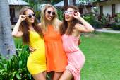 Outdoor portrait of three young women — Stockfoto