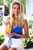 Woman drinking fresh mango juice — Stock Photo