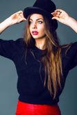 Elegant woman wearing cylinder hat — Stock Photo