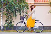Hipster girl with retro bike outdoors — Stock Photo