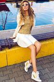 Girl sitting an bench near blue sea — Stock Photo