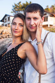 Young happy couple posing outdoor — Stock Photo