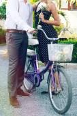 Couple in love posing near retro bike — Stock Photo