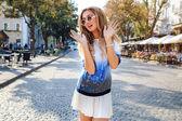 Blonde girl having fun at the street — Stock Photo