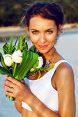 Bride with exotic lotus bouque — Stock Photo