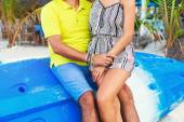 Couple in love sitting at tropical beach — Stock Photo