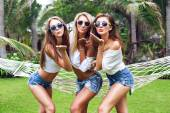 Young women sending air kisses — Stock Photo