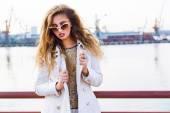 Lady model posing at sea port — Stock Photo