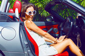 Woman posing outdoor in luxury car — Stock Photo