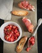 Fresh tomato salad with basil, toasts and ham — Stock Photo