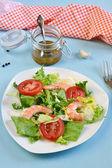 Salad with tomato, king shrimps and sauce vinaigrette — Stock Photo